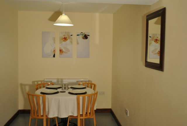 2 Bed Room Holiday Cottage Dinning Room at the Acland Self-catering Accommodation, Stogursey, Bridgwater, Somerset