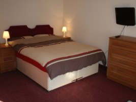 Bedroom for the Hinkley accommodation at the Acland Apartments Stogursey Bridgwater Somerset